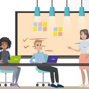 Mitarbeiter sitzen vor einem Whiteboard am Schreibtisch